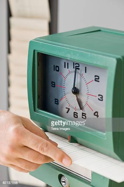 Man punching card in time clock