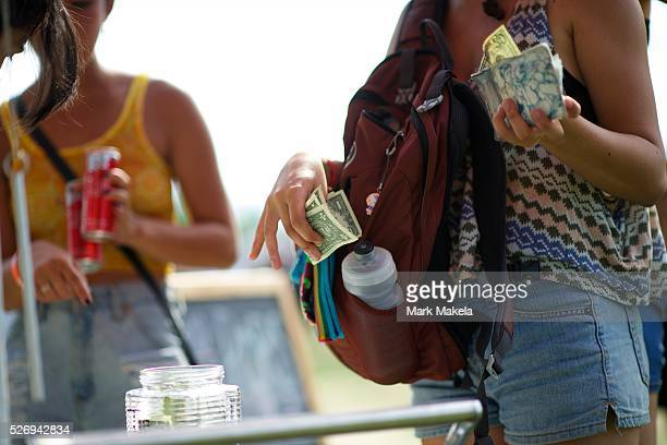 A man purchases alcohol during the Governors Ball Music Festival on Randall's Island in New York NY on June 8 2014