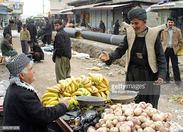 A man purchases bunch of banana at a market on December 11 2006 in Halabja Iraq