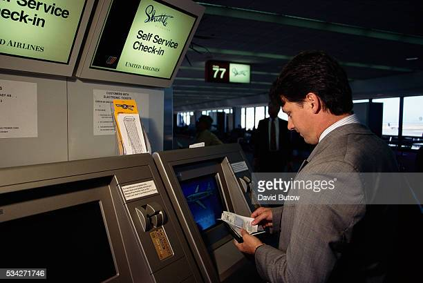 A man purchases his ticket via computer for a United Shuttle flight at San Francisco International Airport