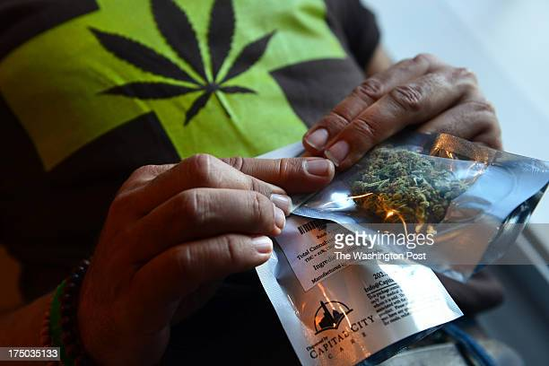 A man purchases medical marijuana the first legal sale at Capital City Care in Washington DC on July 29 2013 The medical marijuana business located...