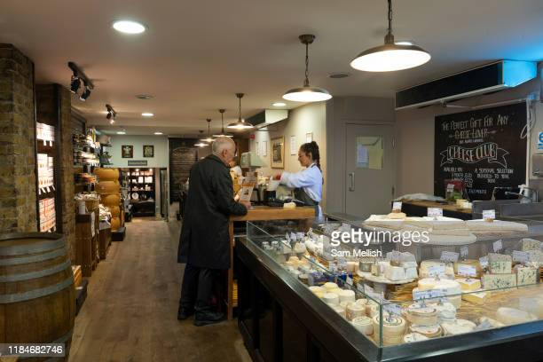 A man purchasing cheese from Paxton Whitfield shop on Jermyn Street on the 26th September 2019 in London in the United Kingdom