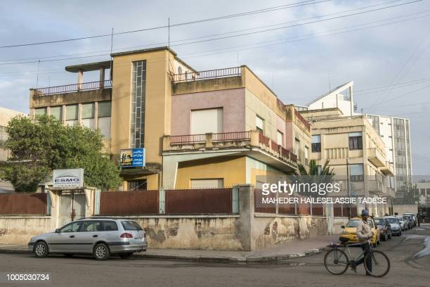 Man pushes a bycicle in the streets of the Eritrean capital Asmara on July 21, 2018. - Located at over 2000 metres above sea level, the capital of...