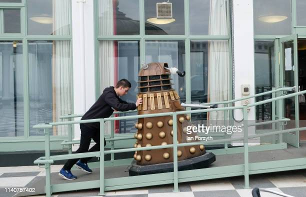 Man pushes a Dalek as it is brought into Scarborough Spa Complex on the first day of the Scarborough Sci-Fi weekend on April 06, 2019 in Scarborough,...