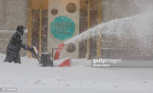 A man pushes a snow blower on Boylston Street in Boston on Jan 4 2018