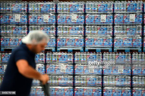 A man pushes a trolley in the new mineral water bottling plant of new mineral water bottling plant for Nestle Vera Naturea water located in...
