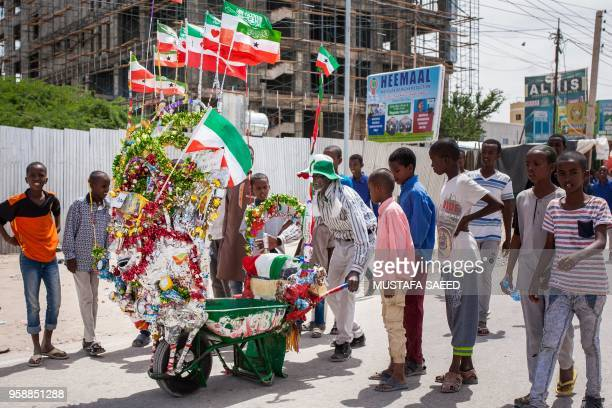 A man pushes his decorated wheelbarrow during celebrations of the 27th anniversary of selfdeclared independence of Somaliland in Hargeisa...