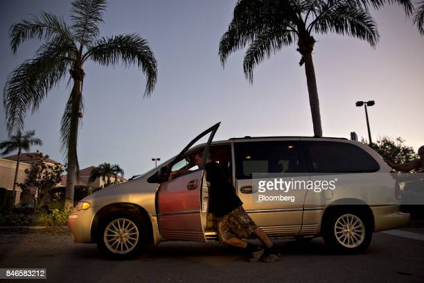 A man pushes his van which ran out of gas during a nearly 5 hour wait in line toward a gas station in Estero Florida US on Tuesday Sept 12 2017 Seven...