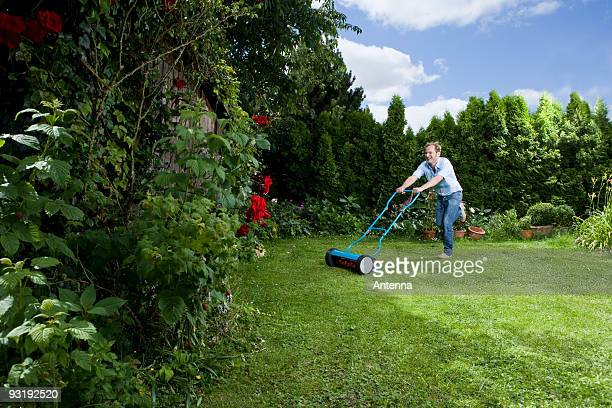 A man pushing a mower