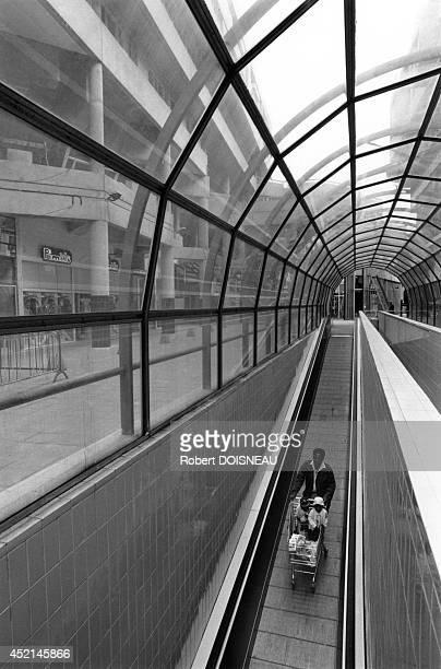 Man pushing a supermarket trolley 1987 in SaintDenis France