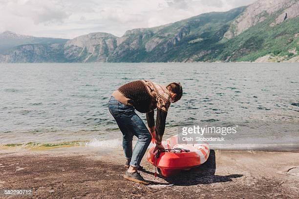 Man pushing canoe