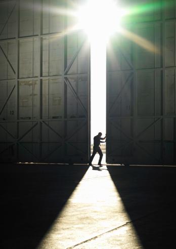 man pushing door open - gettyimageskorea