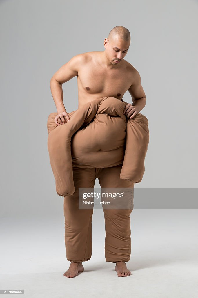 Man pushing off fat suit : Stock-Foto
