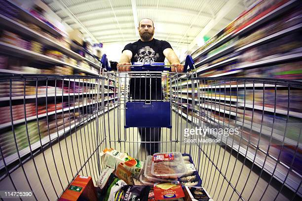 Man pushing shopping trolly