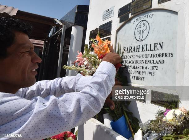 A man puts flowers on the tomb of Briton Sarah Ellen considered one of the lovers of Count Dracula and executed in her hometown of Blackburn England...