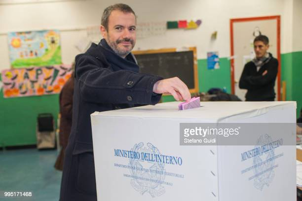 Man puts his ballot in to the polls during Constitutional referendum to change the Italian Constitution, voting with a Yes or a No. Italians are...