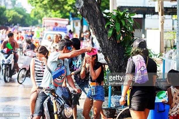 Man puts water on thai girl