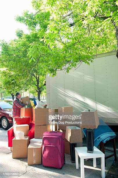 Man putting boxes into moving truck