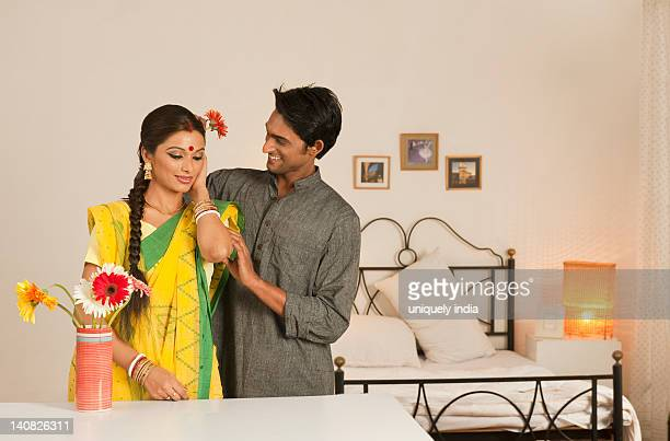 Man putting flower in his wife's hair