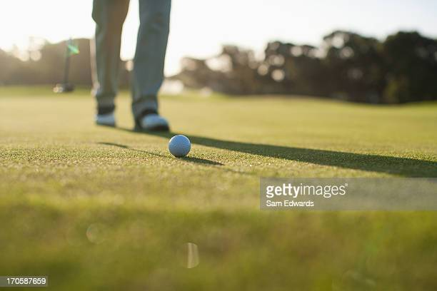 man putting golf ball - putting stock photos and pictures