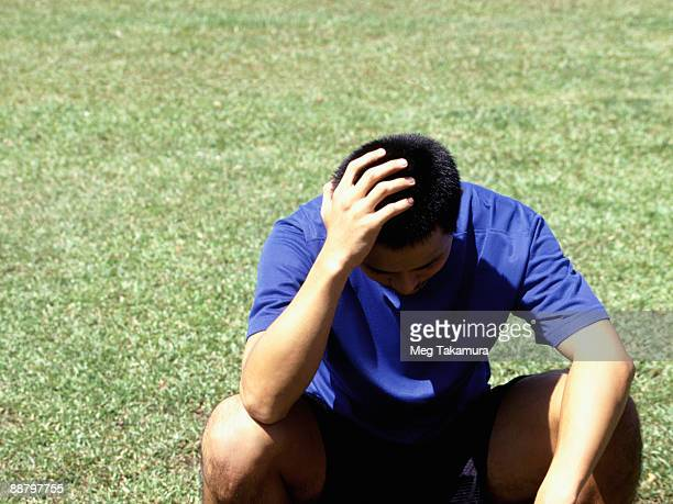 man putting his hand on his head - defeat stock pictures, royalty-free photos & images