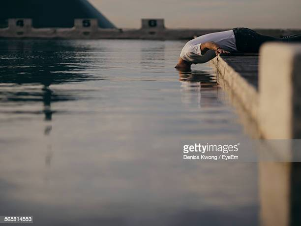 Man Putting His Head In Water