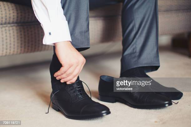 Man putting his shoes on
