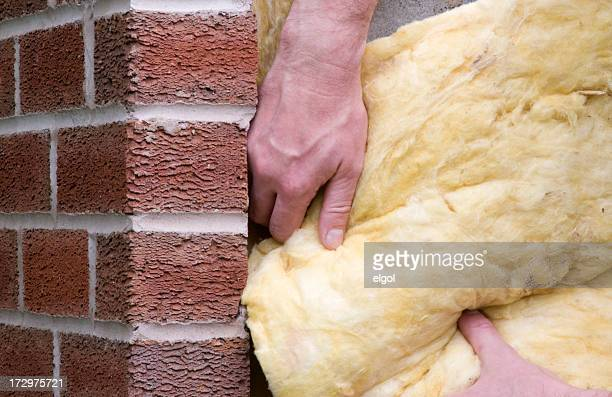 Man putting insulation into a property