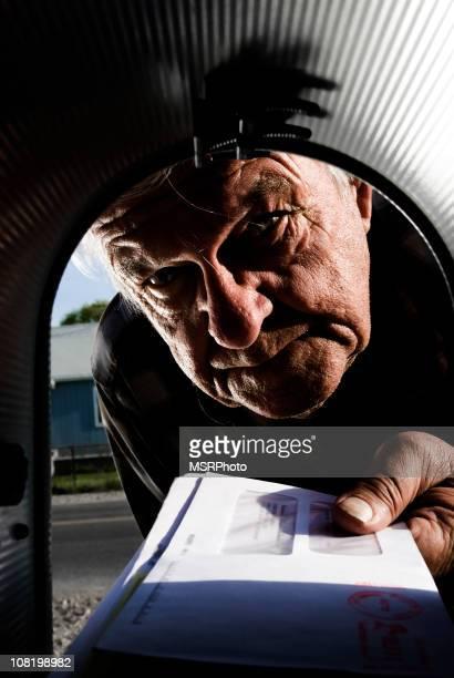 Man Putting Mail in Mailbox
