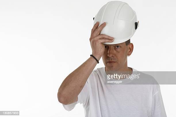 Man putting on a safety helmet, hardhat