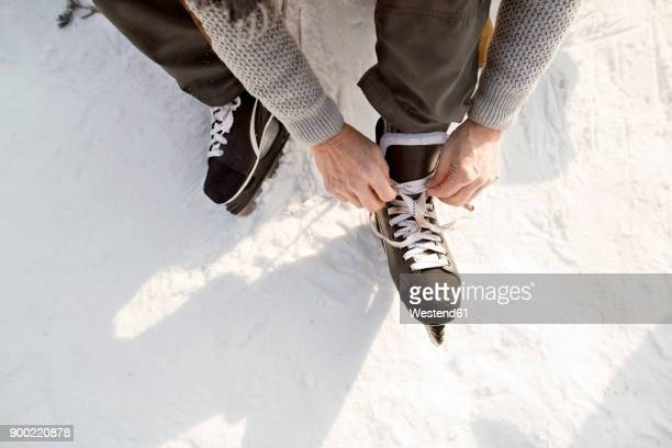 Man putting on ice skates