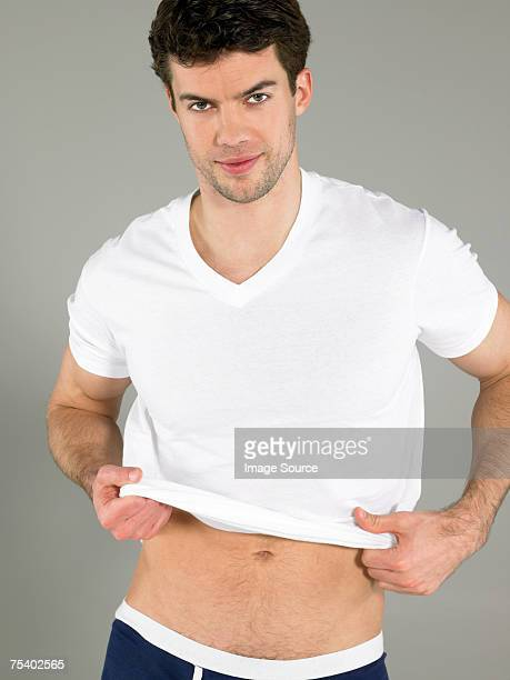 Man putting t-shirt on