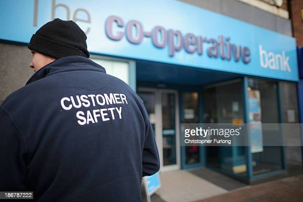 A man queues for the cashpoint machine at the Crewe branch of the Cooperative Bank on November 4 2013 in Crewe United Kingdom The Cooperative Bank...