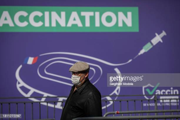 Man queues outside the Paris Stade de France following its conversion into a Covid-19 vaccination centre on April 7, 2021 in Saint-Denis, France.