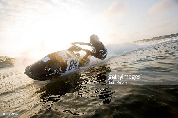 man racing jet ski - jet ski stock pictures, royalty-free photos & images