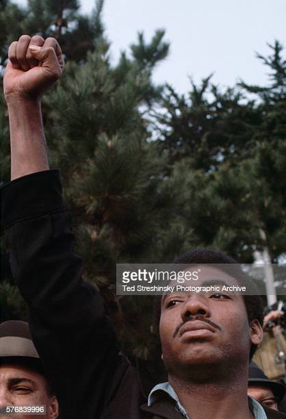 Man raises his fist in a gesture of Black Power during a student strike at San Francisco State College. The students went on strike against the...