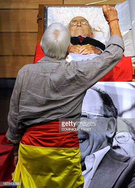 A man raises his fist in front of the body of Spain's former Communist Party leader Santiago Carrillo at a funeral chapel in Madrid on September 19...