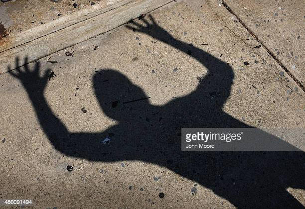 A man raises his hands during a prayer for prosperity at an evangelical service along the Atlantic City Boardwalk on August 29 in Atlantic City New...