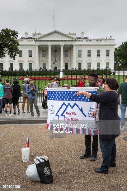 A man raises money for Haiti charity programs in front of the White House on June 4 2018 in Washington DC The nation's capital the sixth largest...
