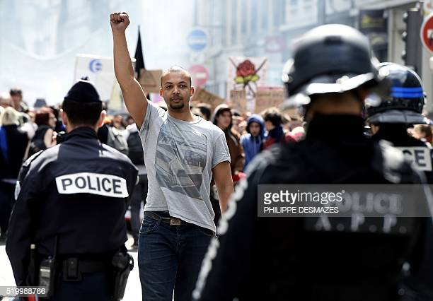 A man raises the fist in front of French riot police during a protest of nearly 400 protestors against the French government's planned labour reforms...