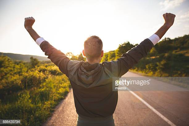 man raising arms - arms raised stock pictures, royalty-free photos & images
