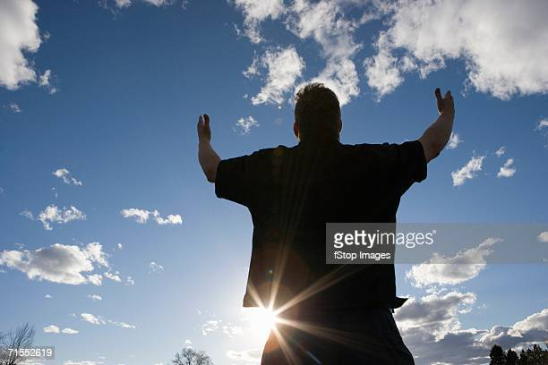 man raising arms toward the sky - miracle stock photos and pictures