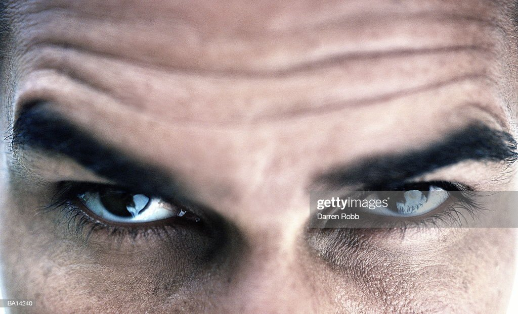 Man raising eyebrow, portrait, close-up : Stock Photo