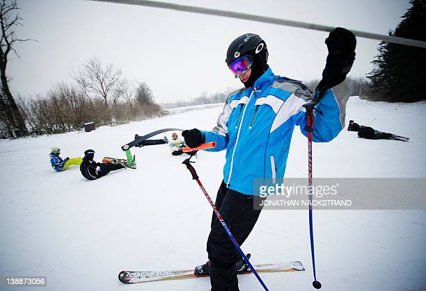 A man reaches the top of the Bornholm Ski Hill on February 4 2012 near the village of Godhjem on the Danish island of Bornholm which lies in the...