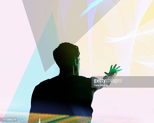 man reaching out to futuristic colourful light - aspirations stock pictures, royalty-free photos & images