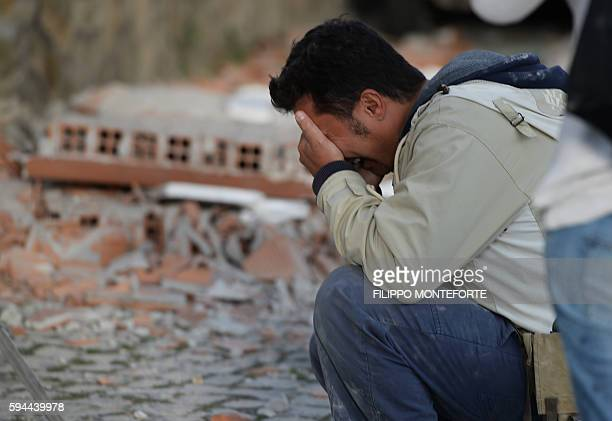 TOPSHOT A man reacts after a strong heathquake hit Amatrice on August 24 2016 Central Italy was struck by a powerful 62magnitude earthquake in the...