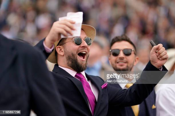 A man reacts after backing a winner at Goodwood Racecourse on August 03 2019 in Chichester England