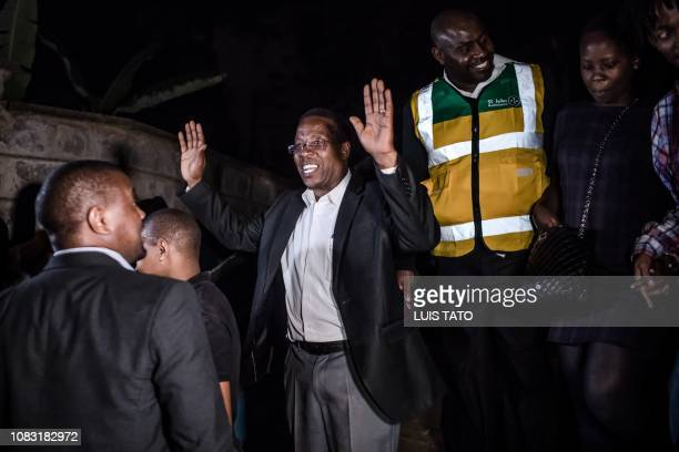 A man reacts after being evacuated from the DusitD2 compound in Nairobi after a blast followed by a gun battle rocked the upmarket hotel complex on...