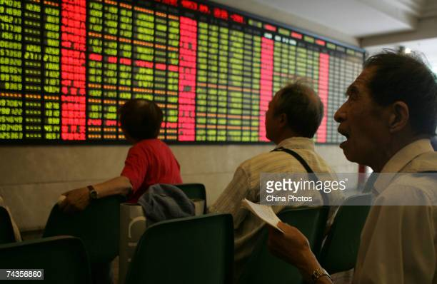 A man reacts amongst investors viewing the stock index at a securities company on May 30 2007 in Shanghai China The Shanghai Composite Index fell by...