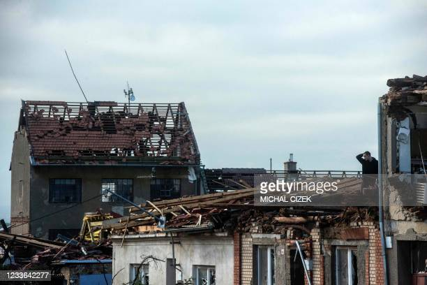 Man reacts as he stands and looks down from his damaged house on June 25, 2021 in the village of Mikulcice, 60 km south of Brno, South Moravia, Czech...